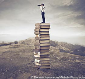 Find Bestselling Book Ideas - Man on a Stack of Books