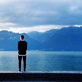 Make Good Decisions - Man Standing in Front of Lake