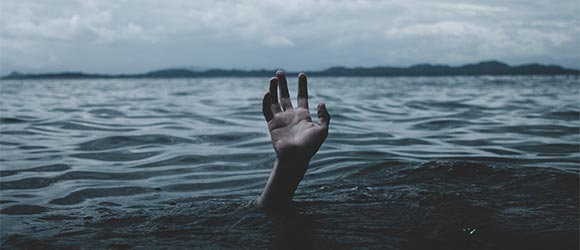 Stop Worrying - Drowning with Hand Reaching for Help